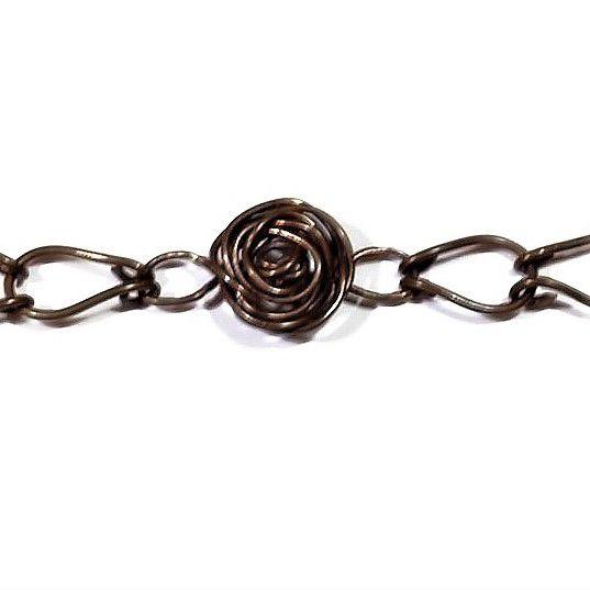 Karkötő rózsával